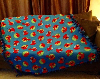 Love Elmo? Stay warm with this Elmo fleece blanket