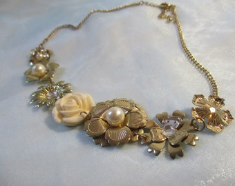 Gold Tone. Assorted Metal  Flowers and 1 Resin or Ceramic Rose,Faux Pearls and Rhinestones Necklace