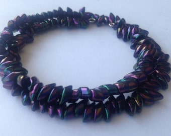 Memory wire bracelet with purple magatama beads