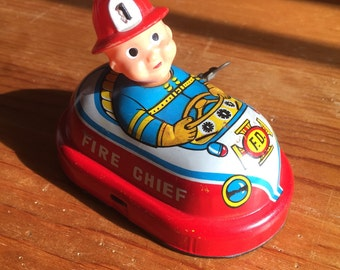 Vintage Yone fire chief windup tin toy made in Japan