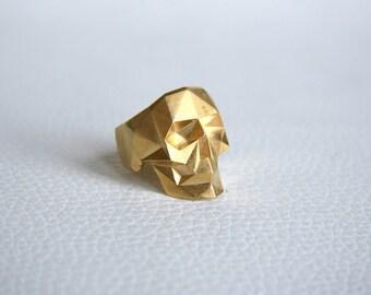 Golden faceted skull ring