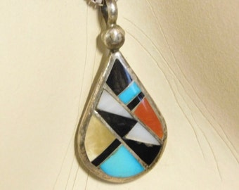Navajo inlaid pendant in sterling--signed by artist