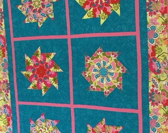 Bright Stack n' Whack quilt block pattern, Pinks, Teals and Greens.