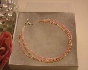 Pink and Silver Triple Strand Bracelet