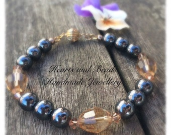 Semi precious hematite and caramel coloured  Swarovski crystal beaded bracelet