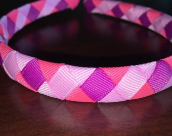 Pink grosgrain ribbon woven headband on 1/2 inch plastic headband