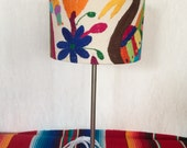 Lamp with metal base, upholstered with multicolour or beige fabric