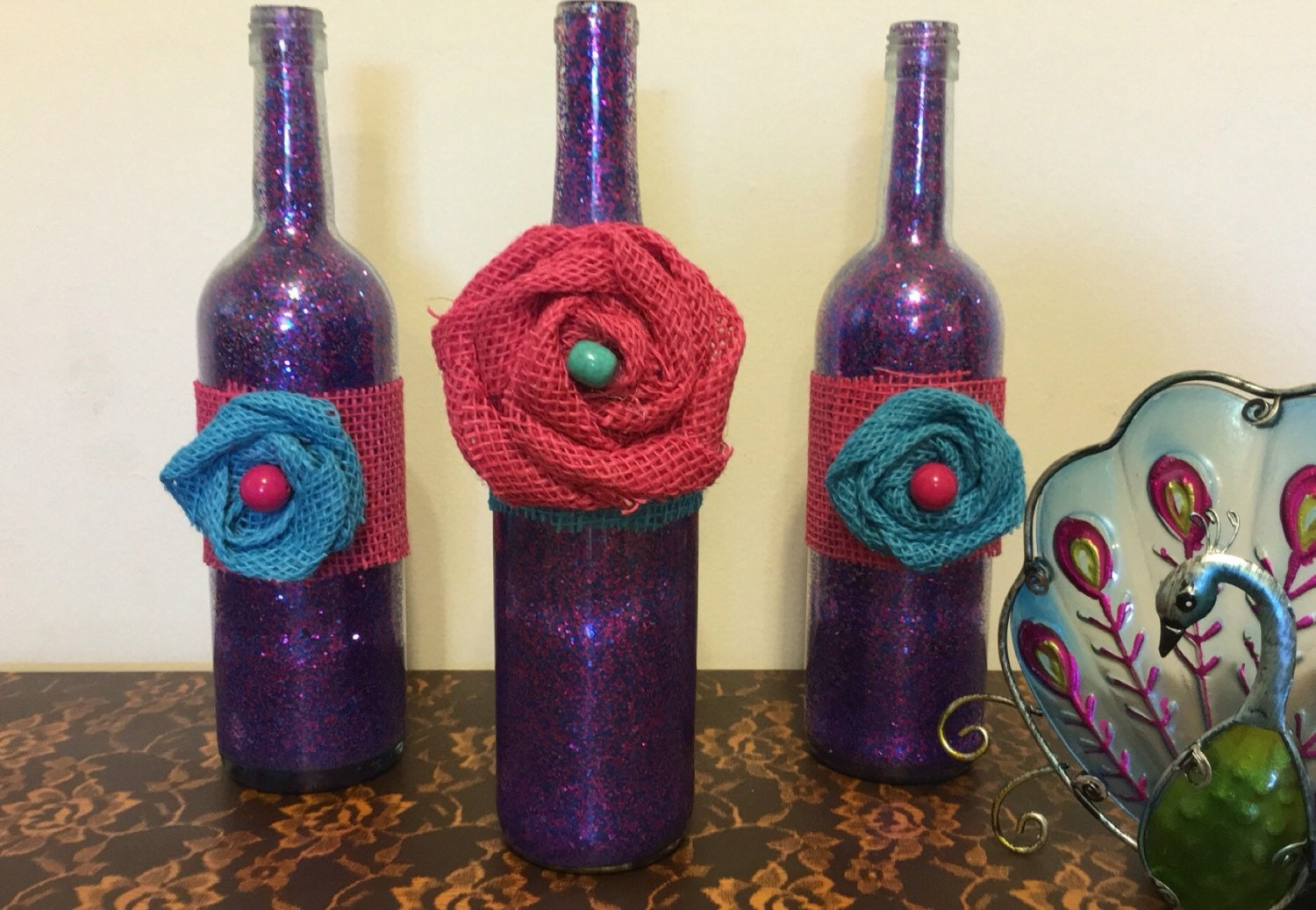 Purple pink glitter wine bottle decor with pink blue burlap for Decorating wine bottles with glitter