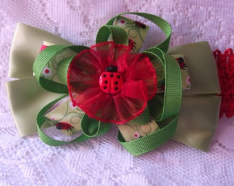 Child's sage/green flower bow headband