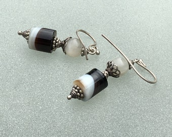 Earrings of banded agate, moonstone and Bali silver. Cylindars of coffee and cream