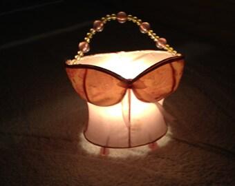Omg. A pink beaded push up bra lamp. Holy Hannah