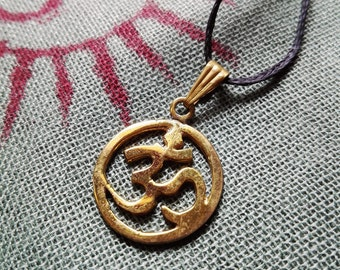"Golden brass pendant ""Om"""
