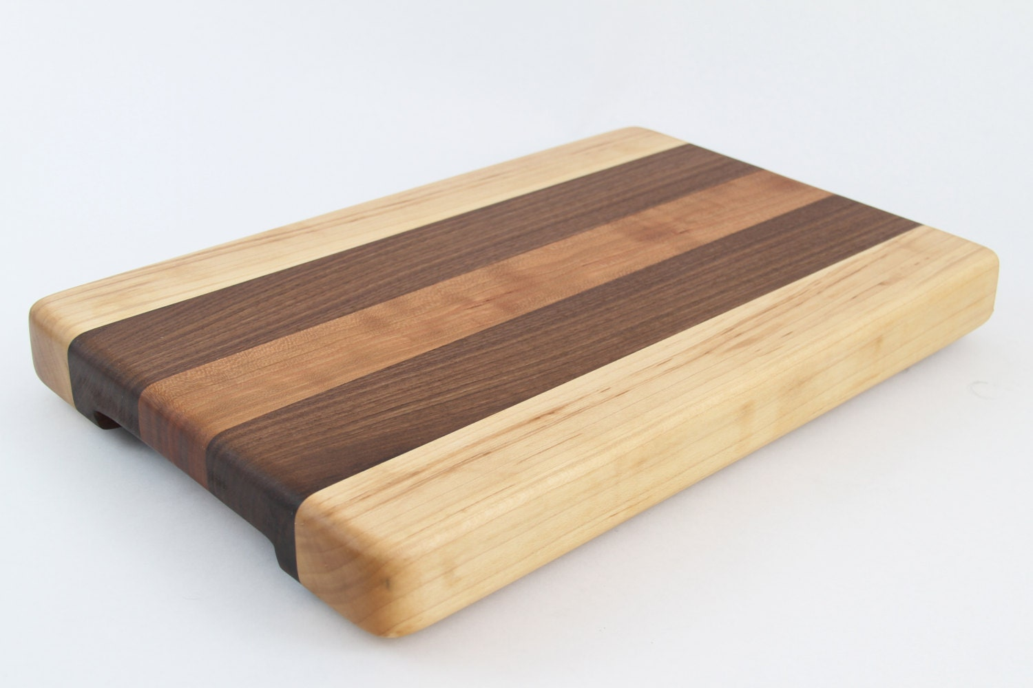 Handcrafted wood cutting board edge grain walnut cherry and maple