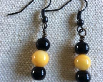 Drop earrings, dangle earrings, black and gold beaded earrings.