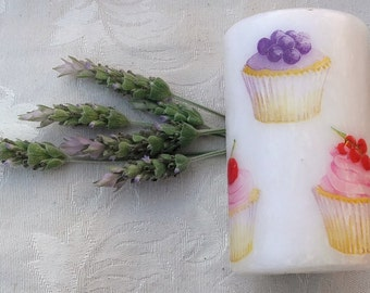 "Candle decorated with the technique of decoupage ""cupcakes""."