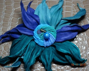 Flower brooch, leather