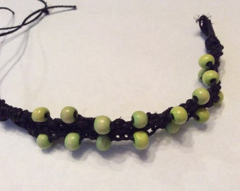 Black hemp bracelet with light green beads