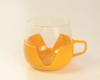 1960's yellow plastic and glass mugs