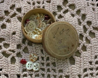 Small box with small white and red vintage buttons