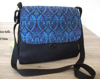 Blue and black adjustable shoulder bag