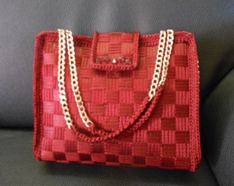 network weaving red purse