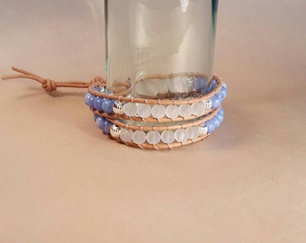 Blue shell and matte quartz beaded leather wrap bracelet with silver accents