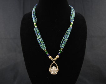 Multistrand necklace with pendant