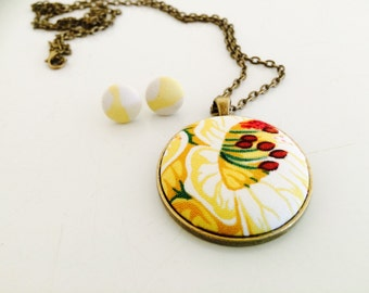 Mustard yellow floral pendant and matching earrings .