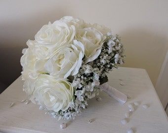 White rose bridal bouquet with gypsophila collar