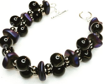 Glass beads mingle with purple dyed hematite braclet