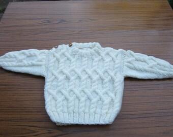 Knitted Aran design round neck jumper
