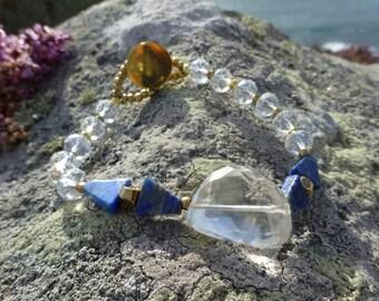 Gemstone bracelet, himalayan crystal, lapis lazuli, brass beads and vintage brass button.UK seller