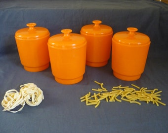 Four 1970s orange plastic boxes