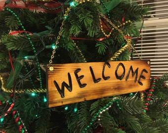 Handmade carved WELCOME SIGN.