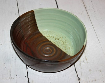 red brown and green ceramic serving bowl