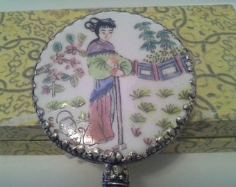 Chinese themed hand mirror with jade like handle