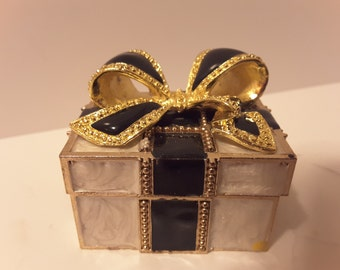 Gold tone metal box with bow