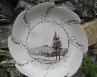 Vintage porcelain bowl and a plate of hand-painted and gilt landscape