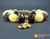 OM meditation bracelet Yellow black jewelry Amber crystal beads Yellow amber bracelet Yoga healing bracelet Gold pendant bracelet Gift for