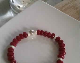 An elegant elastic bracelet made with brazilian ruby and sterling silver beads. The red is very  rich and beautifil