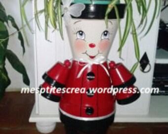 Standing figure in Terra cotta pot