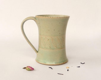 Green mug,  feathers decoration, stoneware