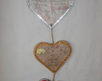 Mdf hanging hearts, three varying sizes.
