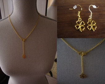 Golden adornment made hand 'Chance' 4-leaf clover composed of a necklace and a pair of earrings