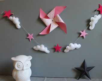 Wreath of clouds and pink stars