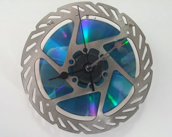 Bicycle rotor wall clock with CD as background
