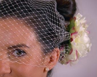 Birdcage veil with peony flower