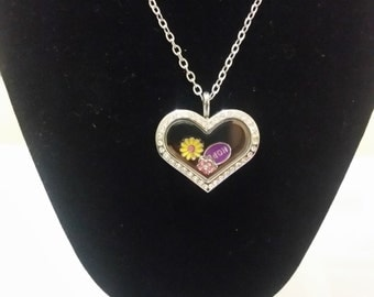 Beautiful stainless steel crystal heart locket filled with happy charms and a 60cm stainless steel chain