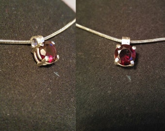 Garnet and silver pendant.