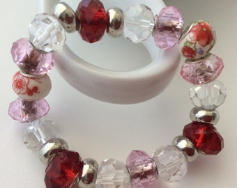 Rose blossom With Ruby Red and Pale Pink Munro beads.